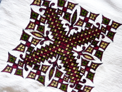 cushion featuring Ethiopian embroidered cross